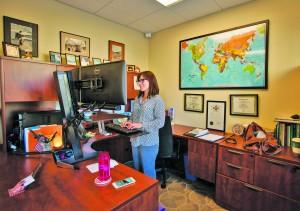 Mandy Hansen, director of the Global Engagement Office, stands at her desk in Copper House. Megan Lunsford | The Scribe