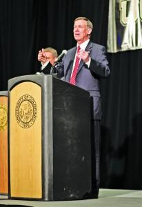 Governor Hickenlooper speaks at the gubernatorial debate in fall 2014. Archives | The Scribe