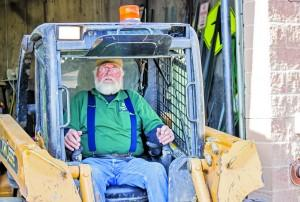 Doug Cook, part of the grounds crew, operates a skid-steer. Ben Patzer | The Scribe