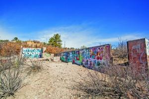 Graffitied concrete stand abandoned along one campus trail.  Megan Lunsford | The Scribe