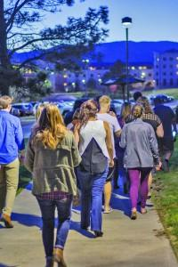 The participants walk and chant to represent 'Taking Back The Night.' Austin Chasse | The Scribe