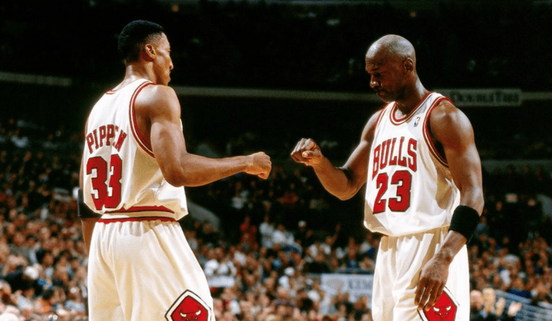 Two Chicago Bulls players fist-bumping